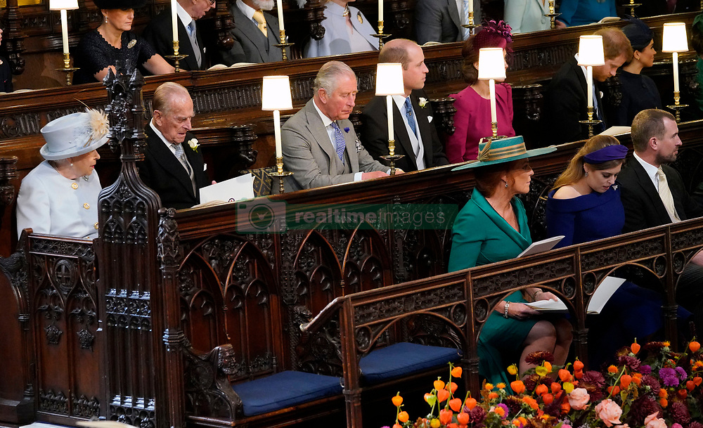 Queen Elizabeth II, the Duke of Edinburgh, Prince of Wales, the Duke and Duchess of Cambridge, the Duke and Duchess of Sussex, sit behind Sarah Ferguson and her daughter Princess Beatrice, at the wedding of Princess Eugenie to Jack Brooksbank at St George's Chapel in Windsor Castle.
