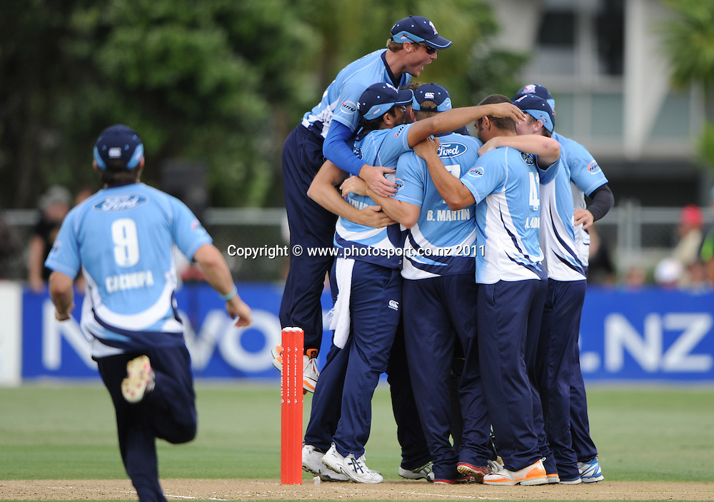 Auckland players celebrate winning the match at the HRV Twenty20 Cricket Final between the Auckland Aces and Canterbury Wizards at Colin Maiden Oval in Auckland, New Zealand on Sunday 22 January 2012. Photo: Andrew Cornaga/Photosport.co.nz