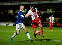 STEVENAGE, ENGLAND - Saturday, January 25, 2014: Everton's Steven Naismith in action against Stevenage's captain Jon Ashton during the FA Cup 4th Round match at Broadhall Way. (Pic by Tom Hevezi/Propaganda)