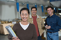 Men and woman in distribution warehouse Portrait