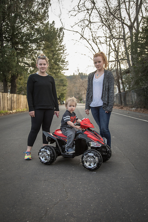 """""""I'm happy it only goes 2.5 mph...I can catch him.""""  -Courtney Stockton (right) with her two year old son, Theo, and friend, Jordan VanDine on North Oak Street in Calistoga"""