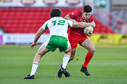 11th November 2018 , Racecourse Ground,  Wrexham, Wales ;  Rugby League World Cup Qualifier,Wales v Ireland ; Josh Ralph of Wales is tackled by Tyrone McCarthy of Ireland <br /> <br /> <br /> Credit:   Craig Thomas/Replay Images