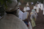 Pilgrims celebrate Saint George day at Lalibela's Bete Giyorgis rock-hewn Church. Located at 2,500 meters above sea level, Lalibela is one of Ethiopia's holiest cities and a center of pilgrimage for the Ethiopian Orthodox Christian population. Declared a UNESCO World Heritage Site, Lalibela's rock-hewn churches were built in the 12th and 13th centuries and are said to represent a miniature version of Jerusalem.  Lalibela, Amhara Division, Ethiopia. April 1, 2011.