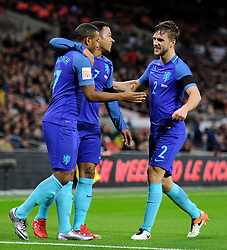 Luciano Narsingh of the Netherlands celebrates his goal with Memphis Depay of the Netherlands and Joel Veltman of the Netherlands   - Mandatory by-line: Alex James/JMP - 29/03/2016 - FOOTBALL - Wembley Stadium - London, United Kingdom - England v Netherlands - International Friendly