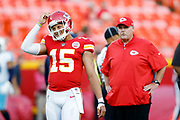 Kansas City Chiefs quarterback Patrick Mahomes, left, and Chiefs head coach Andy Reid, right, before a football game against the Titans at Arrowhead Stadium in Kansas City, Mo., Thursday, Aug. 31, 2017. (AP Photo/Colin E. Braley)