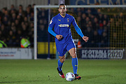 AFC Wimbledon defender Rod McDonald (4) dribbling during the EFL Sky Bet League 1 match between AFC Wimbledon and Ipswich Town at the Cherry Red Records Stadium, Kingston, England on 11 February 2020.