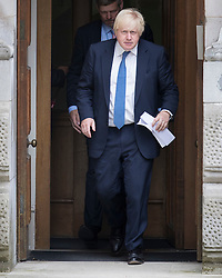 © Licensed to London News Pictures. 15/07/2016. London, UK. New Foreign Secretary Boris Johnson waves as he leaves  the Foreign Office via the Ambassadors Entrance.  Photo credit: Peter Macdiarmid/LNP
