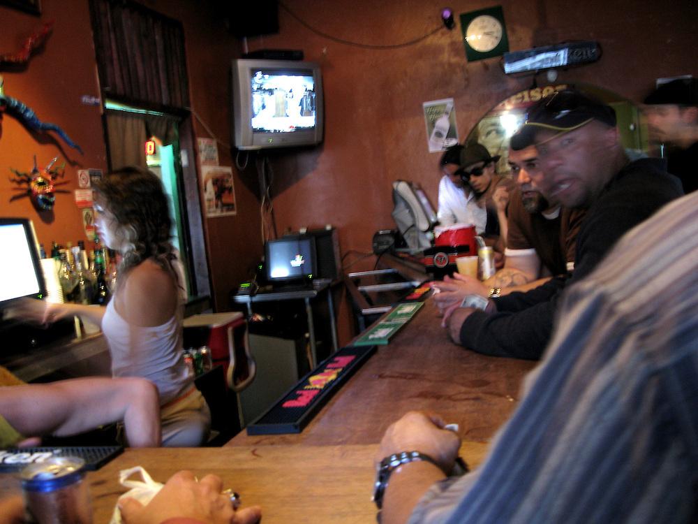 9/13/08------ Patrons crowd the bar in El Boricua, a bar near the University of Puerto Rico in Rio Piedras, Puerto Rico..Photo by Angel Valentin, copyright 2009.