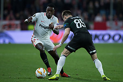 December 13, 2018 - Seville, Andalucia, Spain - Quincy Promes of Sevilla FC and Dmitri Stotski of krasnodar fight for the ball during the Europa League match between Sevilla FC and Krasnodar in Ramón Sánchez Pizjuán Stadium (Seville) (Credit Image: © Javier MontañO/Pacific Press via ZUMA Wire)