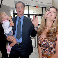 First Lady Maria Shriver and her brother Santa Monica Mayor Bobby Shriver (holding his daughter Rosemary, 18 mo.) meet and greet during the National Center on Addiction Substance Abuse's (CASA) Family Day - A Day to Eat Dinner with Your Children(TM) at the Santa Monica YMCA on Tuesday, September, 28, 2010..