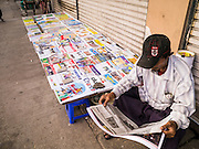 17 JUNE 2013 - YANGON, MYANMAR: A newspaper vendor in Yangon. The Burmese newspaper industry has enjoyed explosive growth this year after private ownership was allowed in 2013. Private newspapers were shut down under former Burmese leader Ne Win in the early 1960s. The revitalized private press is a sign of the dramatic changes sweeping Myanmar, formerly Burma, in the last three years.      PHOTO BY JACK KURTZ