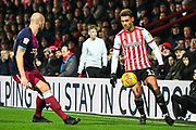 Brentford Forward Oliver Watkins (11) and Aston Villa Defender Alan Hutton (21) in action during the EFL Sky Bet Championship match between Brentford and Aston Villa at Griffin Park, London, England on 13 February 2019.