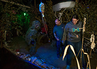 Swamp Man gives Jim Sulloway and Sabrina Alder a scare as they make their way through The Haunted House in Hill on Friday evening.  (Karen Bobotas/for the Laconia Daily Sun)