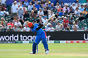 Dawlat Zadran of Afghanistan hits the ball to the boundary for four runs during the ICC Cricket World Cup 2019 match between Afghanistan and Australia at the Bristol County Ground, Bristol, United Kingdom on 1 June 2019.