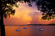 A rainbow exits the clouds over sailboats moored on Lake Superior at Marquette Michigan.