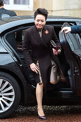© Licensed to London News Pictures. 21/10/2015. London, UK. PENG LIYUAN arriving at the event by car. CATHERINE, Duchess of Cambridge, and PRINCE WILLIAM, Duke of Cambridge accompanied Chinese president  XI JINPING and his wife PENG LIYUAN as they attend Creative Collaborations event at Lancaster House in London, as part of the Chinese state visit to the uk. The couples were shown a new Aston Martin DB10 from the Spectre James bond film and new London Bus and taxi transports.  Photo credit: Ben Cawthra/LNP
