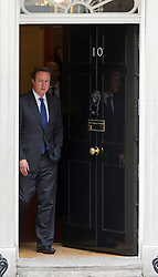 © Licensed to London News Pictures. 09/10/2013. London, UK. The British Prime Minister David Cameron is seen at the door of Number 10 Downing Street as he prepares to meet his Hungarian counterpart, Viktor Orban, in London today (09/10/2013). Photo credit: Matt Cetti-Roberts/LNP