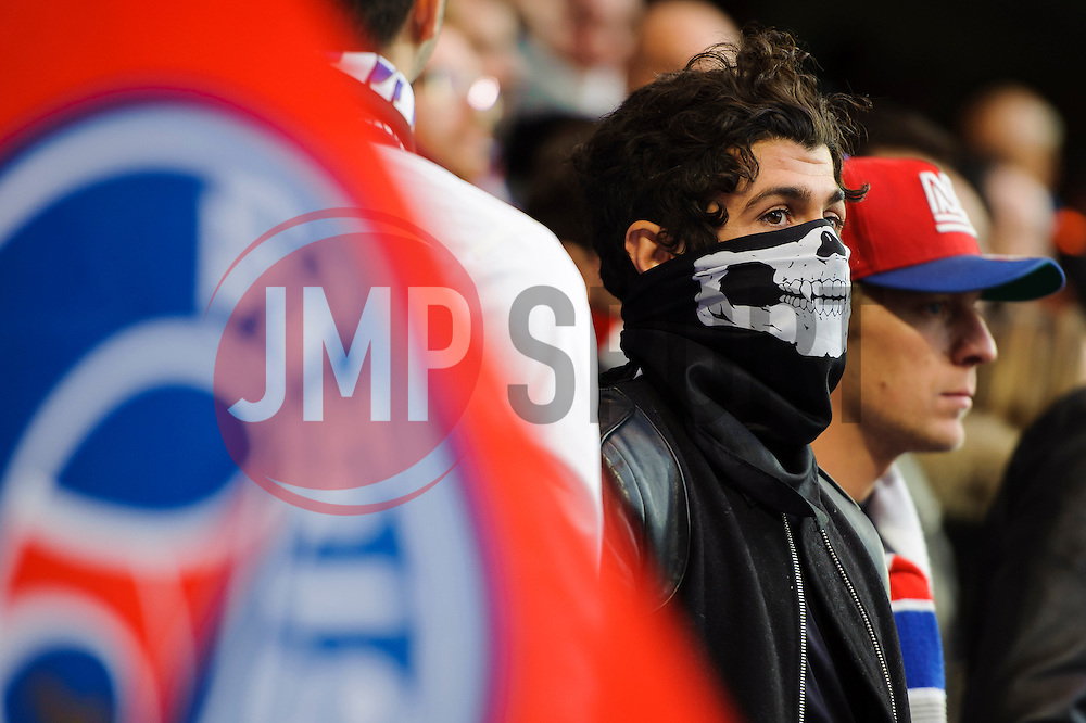 A PSG fan looks on in a face mask - Photo mandatory by-line: Rogan Thomson/JMP - 07966 386802 - 08/04/2014 - SPORT - FOOTBALL - Stamford Bridge, London - Chelsea v Paris Saint-Germain - UEFA Champions League Quarter-Final Second Leg.
