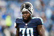 NASHVILLE, TN - NOVEMBER 29:  Chance Warmack #70 of the Tennessee Titans warming up before a game against the Oakland Raiders at Nissan Stadium on November 29, 2015 in Nashville, Tennessee.  The Raiders defeated the Titans 24-21.  (Photo by Wesley Hitt/Getty Images) *** Local Caption *** Chance Warmack