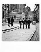 Eton boys four abreast outside School Hall, June, 1933
