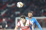 Kgosi Nthle heads clear during the The FA Cup 3rd round match between Doncaster Rovers and Rochdale at the Keepmoat Stadium, Doncaster, England on 6 January 2018. Photo by Daniel Youngs.