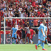 HARRISON, NEW JERSEY- JULY 24: New York Red Bulls fans celebrate as Bradley Wright-Phillips #99 of New York Red Bulls celebrates his second goal with team mates in his sides 4-1 win  during the New York Red Bulls Vs New York City FC MLS regular season match at Red Bull Arena, Harrison, New Jersey on July 24, 2016 in Harrison, New Jersey. (Photo by Tim Clayton/Corbis via Getty Images)