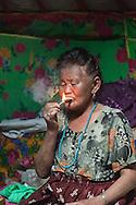 Mongolia. Ulaanbaatar. Mme Tserendolgor,  master shaman  smoking cigarette  . Ulaan baatar