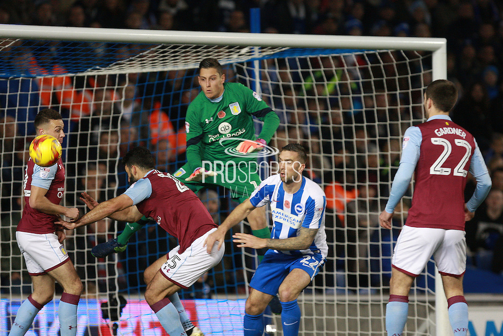 Aston Villa goalkeeper Pierluigi Gollini (1) clears under pressure from Brighton & Hove Albion central defender Shane Duffy during the EFL Sky Bet Championship match between Brighton and Hove Albion and Aston Villa at the American Express Community Stadium, Brighton and Hove, England on 18 November 2016. Photo by Bennett Dean.
