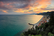 A view at sunset of the small fishermen village of Varigotti in Liguria, Italy, as seen from atop a nearby cliff.
