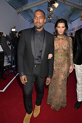 KANYE WEST and KIM KARDASHIAN WEST at British Vogue's Centenary Gala Dinner in Kensington Gardens, London on 23rd May 2016.