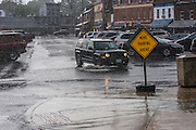 """Annapolis, Maryland - June 05, 2016: An automobile drives through a sizable puddle during a thunderstorm in front of the Harbor Master's office on Dock Street in Historic Annapolis Sunday June 5th, 2016. The puddle is an example of nuisance flooding and was exacerbated by the morning's perigean spring tide and the afternoon's brief thunderstorm.<br /> <br /> <br /> A perigean spring tide brings nuisance flooding to Annapolis, Md. These phenomena -- colloquially know as a """"King Tides"""" -- happen three to four times a year and create the highest tides for coastal areas, except when storms aren't a factor. Annapolis is extremely susceptible to nuisance flooding anyway, but the amount of nuisance flooding has skyrocketed in the last ten years. Scientists point to climate change for this uptick. <br /> <br /> <br /> CREDIT: Matt Roth for The New York Times<br /> Assignment ID: 30191272A"""
