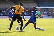 AFC Wimbledon attacker Michael Folivi (17) putting the ball between the legs of Bristol Rovers midfielder Abu Ogogo (4) during the EFL Sky Bet League 1 match between AFC Wimbledon and Bristol Rovers at the Cherry Red Records Stadium, Kingston, England on 21 September 2019.