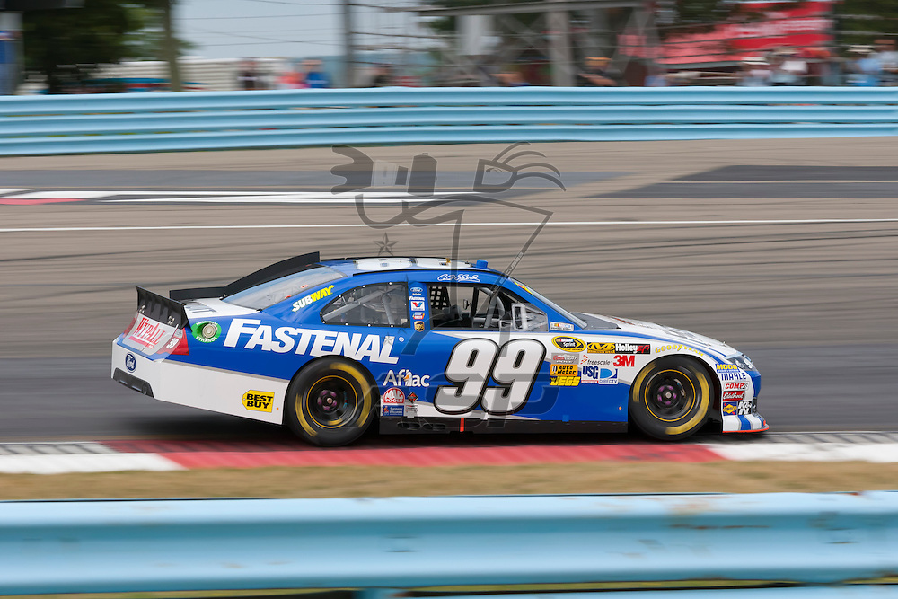 WATKINS GLEN, NY - AUG 12, 2012:  Carl Edwards (99) brings his car through the turns during the Finger Lakes 355 at The Glen Sprint Cup Series race at the Watkins Glen International in Watkins Glen International, NY.