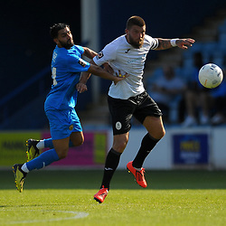 TELFORD COPYRIGHT MIKE SHERIDAN Shane Sutton of Telford heads clear under pressure from Ravi Shamsi during the National League North fixture between AFC Telford United and Leamington AFC at the New Bucks Head on Monday, August 26, 2019<br /> <br /> Picture credit: Mike Sheridan<br /> <br /> MS201920-005