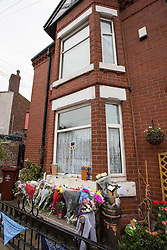 © Licensed to London News Pictures . FILE PICTURE DATED 13/10/2014 . Manchester , UK . Flowers and tributes in front of the home of Jordan Brennan on Peacock Grove , Gorton , left after Jordan Brennan died . A 17 year old who cannot be named for legal reasons has today (19th March) been sentenced to eight months after earlier pleading guilty to killing Jordan Brennan in Gorton , Manchester . 17 year old Jordan Brennan was found dead in his bed by his mother on the morning of Saturday 11th October following an assault outside a local grocery the night before .Photo credit : Joel Goodman/LNP