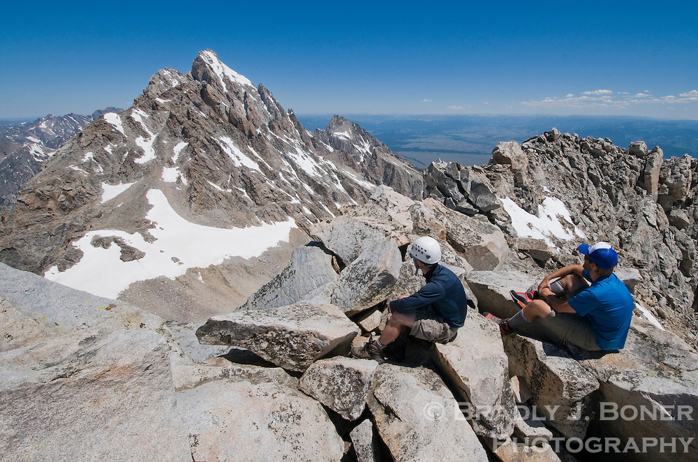 Brett Boeckel and Doug Hayden take in the view from the summit of the South Teton, ele. 12,513, on Saturday in Grand Teton National Park. There is still some snow near the upper section of north side of the South Teton, and an ice axe and an early start are recommended for a successful summit.