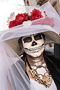 A women costumed as La Calavera Catrina during the Day of the Dead festival October 28, 2016 in San Miguel de Allende, Guanajuato, Mexico. The week-long celebration is a time when Mexicans welcome the dead back to earth for a visit and celebrate life.