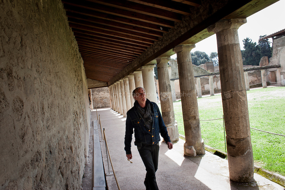 POMPEII, ITALY - 4 APRIL 2013: Mattia Buondonno, 50, guide of the Superintendence of Pompeii, walks in the peristyle of the Stabian Baths, the city's most ancient bath building (2nd century BC),  in Pompeii, Italy, on April 4th, 2013...In recent years, a series of collapses at the site have alarmed conservationists, who warn that the ancient Roman city is dangerously exposed to the elements ? and poorly served by the red tape, lack of strategic planning and limited personnel of the site's historically troubled management. ..Pompeii, along with Herculaneum, was buried under 4 to 6 meters (13 to 20 ft) of ash and pumice in the eruption of Mount Vesuvius in 79 AD. After its initial discovery in 1599, Pompeii was rediscovered as the result of intentional excavations in 1748 by the Spanish military engineer Rocque Joaquin de Alcubierre...Pompeii is an UNESCO World Heritage Site and one of the most popular tourist attractions of Italy, with approximately 2.5 million visitors every year...Gianni Cipriano for The New York Times