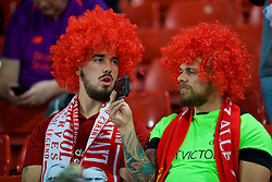 LIVERPOOL, ENGLAND - Wednesday, September 26, 2018: Two Liverpool supporters wearing red curly wigs before the Football League Cup 3rd Round match between Liverpool FC and Chelsea FC at Anfield. (Pic by David Rawcliffe/Propaganda)