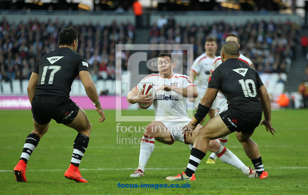 Brett Ferres (C) of England on the attack against Sam Moa (R)  and  Alex Glenn (L) of New Zealand during the Autumn International Series match at Queen Elizabeth Olympic Park, London<br /> Picture by Stephen Gaunt/Focus Images Ltd +447904 833202<br /> 07/11/2015