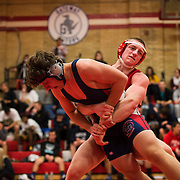 Paulsboro High's Jimmy Sutton grapples Steve Calhoun from Washington Township in the 182-pound quarterfinals of the John and Betty Vogeding Tournament. In 2011, Paulsboro became the third school in the United States to accumulate 1,000 wins.