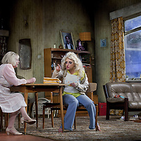 Louise McCarthy  and Barbara Rafferty <br /> <br /> Yer Granny - a new production by The National Theatre of Scotland opens at the Beacon arts Centre, Greenock, Scotland.<br /> <br /> <br /> Based on La Nona by Roberto Cossa<br /> In a new version by Douglas Maxwell<br /> Directed by Graham McLaren<br /> <br /> <br /> Picture by Drew Farrell<br /> Tel : 07721-735041<br /> Image offered on a speculative basis.<br /> <br /> Yer Granny is a riotous new comedy about a diabolical 100-year-old granny who&rsquo;s literally eating her family out of house and home. She&rsquo;s already eaten their fish and chip shop into bankruptcy and now she&rsquo;s working her way through their kitchen cupboards, pushing the Russo family to desperate measures just to survive beyond 1977.<br /> <br /> As proud head of the family, Cammy is determined that The Minerva Fish Bar will rise again and that family honour will be restored &ndash; and all in time for the Queen&rsquo;s upcoming Jubilee visit. But before Cammy&rsquo;s dream can come true and before Her Maj can pop in for a chat, a single sausage and a royal seal of approval, the family members must ask themselves how far they will go to solve a problem like Yer Granny.<br /> <br /> Adapted from the smash-hit Argentinian comedy classic La Nona, the cast of Yer Granny features some of Scotland&rsquo;s best-loved performers, including Gregor Fisher in the title role, alongside Paul Riley (Still Game), Jonathan Watson (Only An Excuse?), Maureen Beattie (Casualty), Barbara Rafferty (Rab C Nesbitt), Brian Pettifer (The Musketeers) and Louise McCarthy (Mamma Mia!, West End).<br /> <br /> Performance dates :<br /> The Beacon Arts Centre, Greenock<br /> 19/05/2015&nbsp;-&nbsp;21/05/2015 <br /> <br /> King's Theatre, Glasgow<br /> 26/05/2015&nbsp;-&nbsp;30/05/2015 <br /> <br /> King's Theatre, Edinburgh<br /> 02/06/2015&nbsp;-&nbsp;06/06/2015 <br /> <br /> Eden Court, Inverness<br /> <br /> Lyric Theatre, Belfast<br /> 23/06/2015&nbsp;-&nbsp;27/06/2015 <br /> <br /> Dundee Rep Theatre<br /> 30/06/2015&nbsp;-&nbsp;04/07/2015