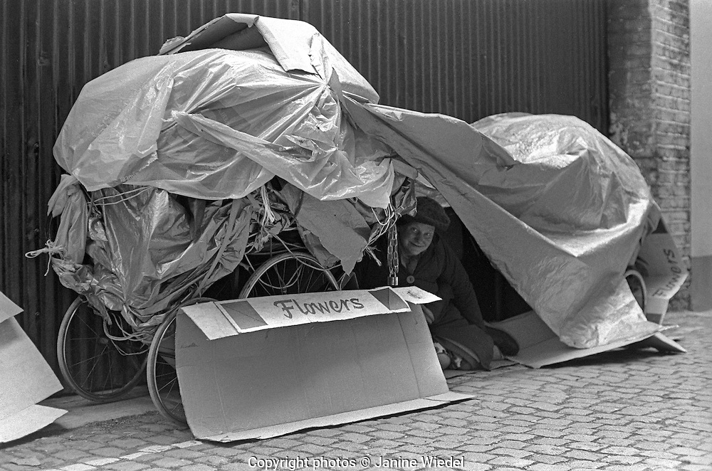 Homeless woman living under prams in Knightsbridge London 1970s