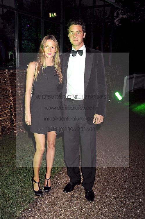 AMANDA CROSSLEY and HARRY LANGTON at the Royal Parks Foundation Summer Party hosted by Candy & Candy on the banks of the Serpentine, Hyde Park, London on 10th September 2008.
