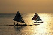 fishing boats return at dawn after night fishing, Tulamben Bay, Bali, Indonesia