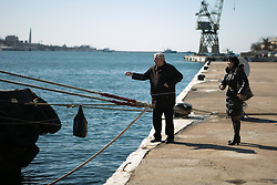 Relatives deliver a couple bags of goods and food for the Ukrainian sailors parade on the warship in Sevastopol bay, Ukraine , Thursday, 13th March 2014. Picture by Daniel Leal-Olivas / i-Images