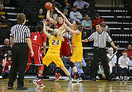 February 11 2013: Nebraska Cornhuskers forward Jordan Hooper (35) is surrounded by Iowa Hawkeyes guard Jaime Printy (24) and Iowa Hawkeyes center Morgan Johnson (12) as she passes the ball to Nebraska Cornhuskers guard Tear'a Laudermill (1) during the first half of the NCAA women's basketball game between the Nebraska Cornhuskers and the Iowa Hawkeyes at Carver-Hawkeye Arena in Iowa City, Iowa on Monday, February 11 2013.