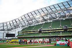 DUBLIN, REPUBLIC OF IRELAND - Wednesday, May 25, 2011: Wales and Scotland players stand for the national anthems in an almost empty stadium before the Carling Nations Cup match at the Aviva Stadium (Lansdowne Road). (Photo by David Rawcliffe/Propaganda)