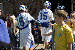 06 May 2007: Duke Blue Devils attackman Max Quinzani (16) and defenseman Parker McKee (35) with fans at half-time in a 19-6 victory over the Air Force Falcons at Koskinen Stadium in Durham, NC.