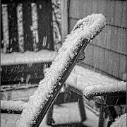 It certainly was snowing that day.  This chair was getting covered with a nicely detailed layer of snow, despite being nearly vertical.  I've tried to bring out lots of details in this black and white image that has a touch of whimsey and fantasy.